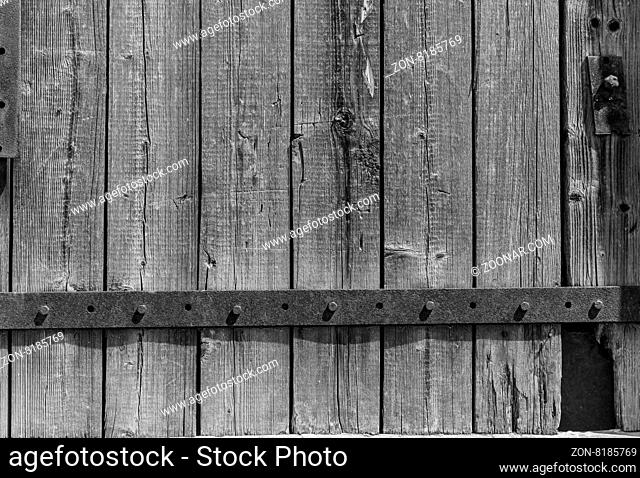 wooden planks background with black metal bar