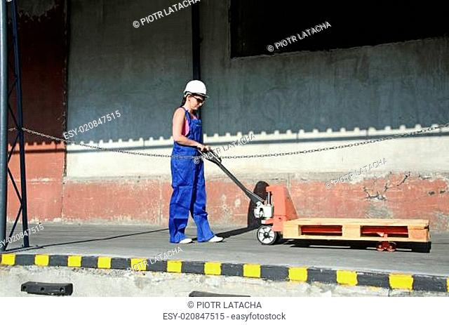 woman working at loading trolley