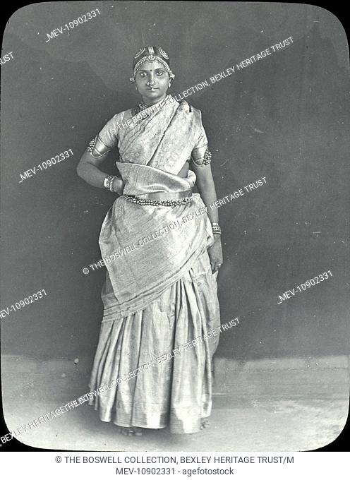 A black and white lantern slide of a girl posing for camera. Slide number 8 of Box 221 Boswell Collection