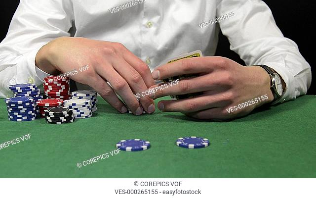 Poker player placing a bet