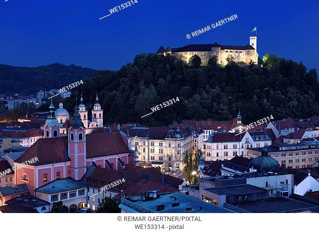 Hlltop Ljubljana Castle overlooking the old town of Ljubljana capital city of Slovenia with Franciscan church and St Nicholas Cathedral at dusk twilight