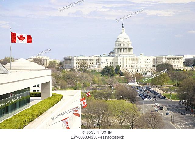 Canadian flag flying from Canadian Embassy in foreground with U.S. Capitol in background, viewed from rooftop of Newseum Museum in Washington D.C