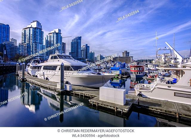 Some tiny house boats in Coal Harbour , Vancouver, British Columbia during a wonderful sunny afternoon in November