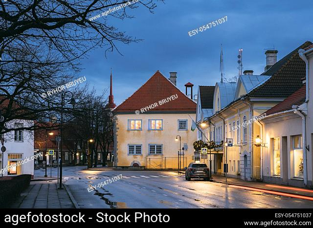 Kuressaare, Estonia. Building Of Noble Assembly And Kuressaare Town Hall At Lossi Street In Evening Or Night Illuminations