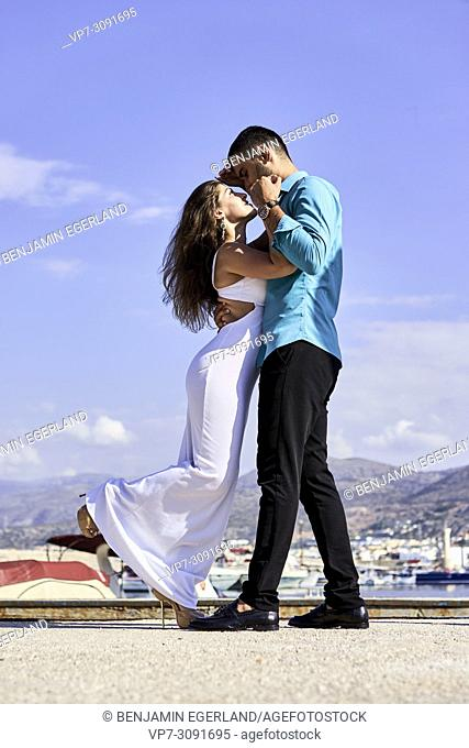 couple at harbour during holiday in Chersonissos, Crete, Greece, enjoying love