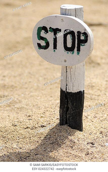 Stop sign on sand, No human allowed for fauna and flora preservation purposes, North Seymour Island, Galapagos Islands, Ecuador