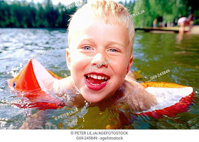 A happy four years boy takes a bath. Medle. Vasterbotten. Sweden
