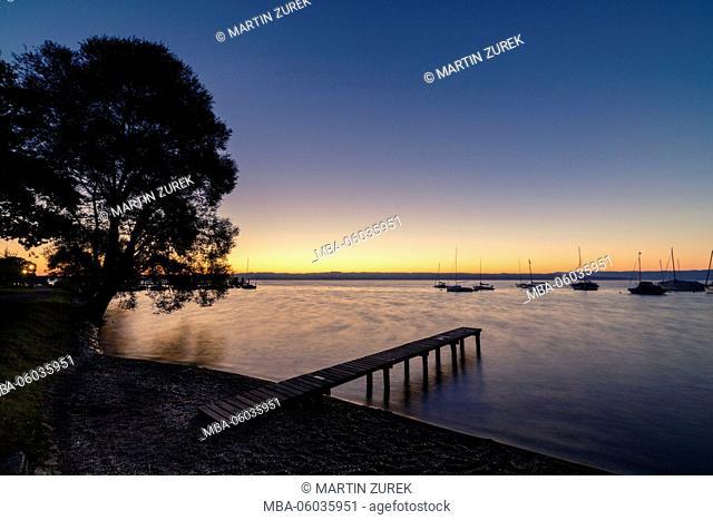 Sunrise in Utting am Ammersee / Lake Ammer, shore, morning, sunlight, lakeside promenade, Germany, Bavaria, Ammersee / Lake Ammer