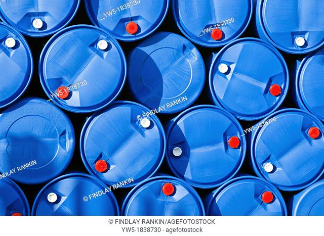 Blue plastic barrels and containers with red and white tops