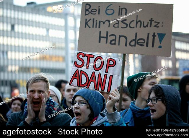 13 January 2020, Hamburg: Climate activists demonstrate during a Fridays for Future protest action in front of the Siemens office in Hamburg