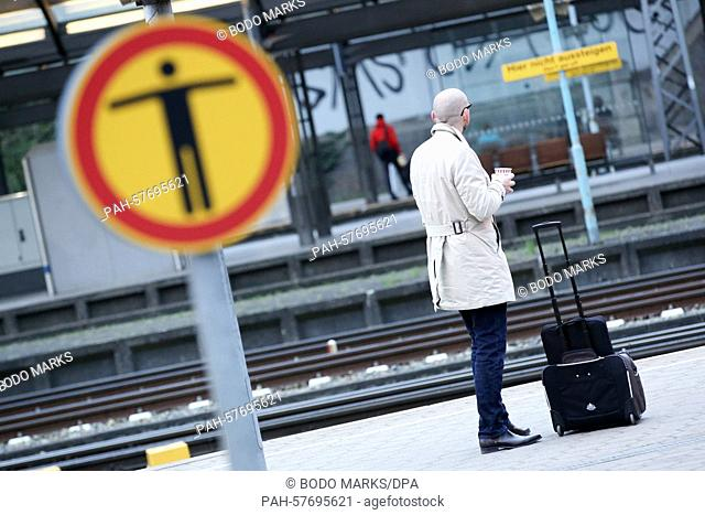 Only a few travellers can be seen on the long-distance train platforms at the main train station in Hamburg, Germany, 22 April 2015