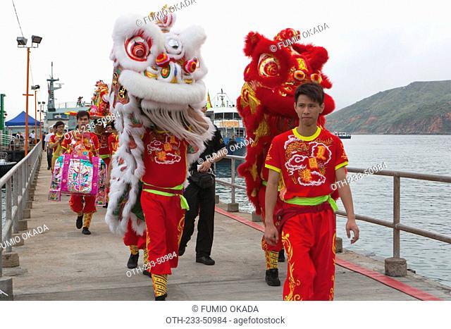 Lion dance at the pier of Joss House bay celebrating the Tin Hau festival, Hong Kong