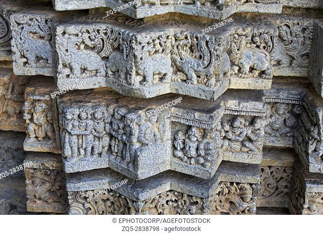 Close up of Shrine wall the star shaped panels depicting the makara, Hindu purana, foliage, top to bottom in the Chennakesava temple, Hoysala Architecture