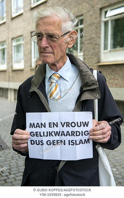 Breda, Netherlands. Male Pegida supporter with sign protesting during a local rally and demonstration. Pegida is a patriotic political organization opposing to...