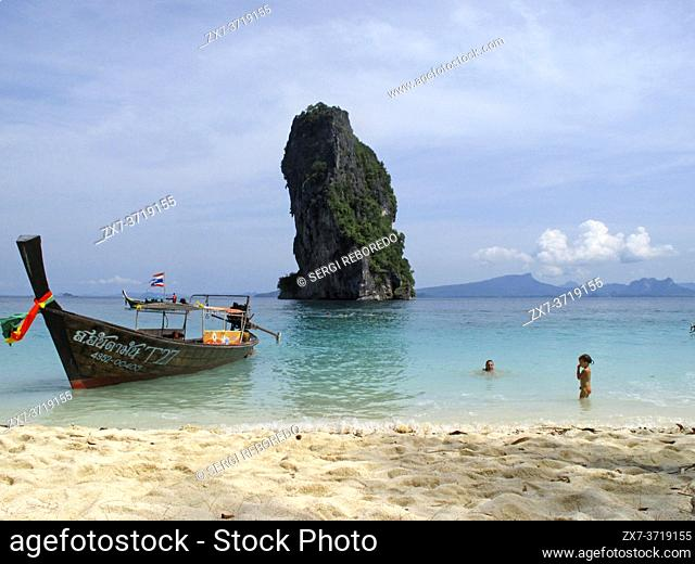 Long-tail boat moored on the beach at Koh Poda Islands in the Andaman Sea, Thailand. Ko Poda is an island off the west coast of Thailand, in Krabi Province