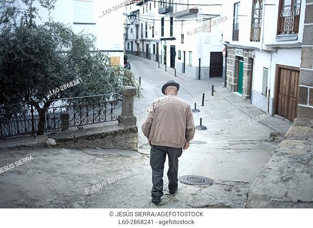 Old man walking in Hervás, Extremadura, Spain