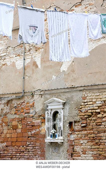 Italy, Venice, Old brick wall, Madonna image, clothesline