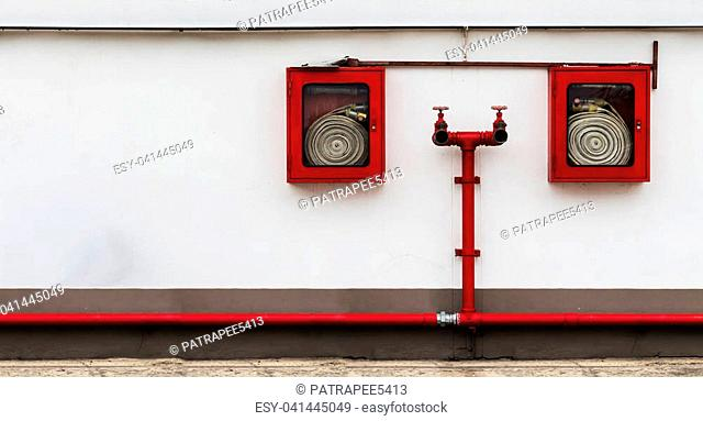 fire hose cabinet on the white wall with many copy space for your text of some idea