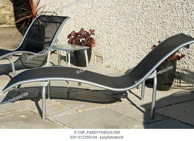 modern silver and black loungers for garden