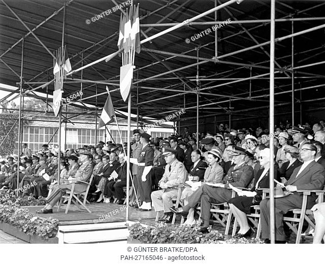 The gathered spectators on the VIP stand watch with interest when a parade of the French squad on the occasion of the French national holiday passes them in the...