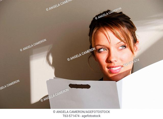 20 yr old young woman holding file folder