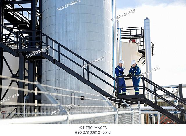 Workers on platform at gas plant