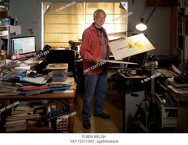 Photographer, Ken Welsh, in his studio; Torremolinos, Malaga, Andalusia, Spain
