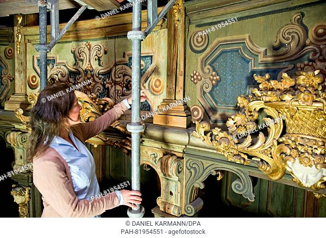 Conservator-restorer Melissa Speckhardt explains the condition before and after restoration, pictured during restoration work on the Margravial Opera House in...