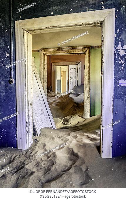 Abandoned house in a small desert village covered with sand