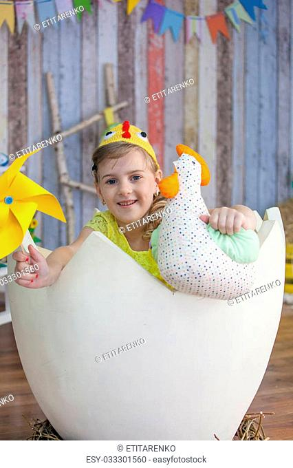 beautiful girl in the yellow chicken costume