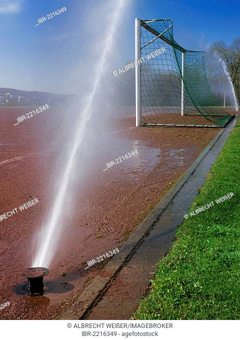 Intensive irrigation of a soccer field, symbolic image for water consumption, wasting of water, Germany, Europe
