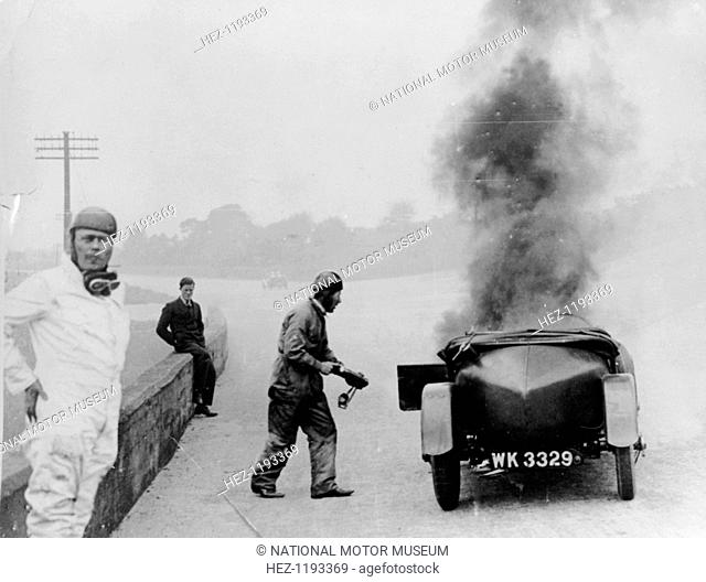 Car on fire, Brooklands, Surrey, 1928. The Lea Francis of Frank Hallam on fire during the annual six hour endurance race held at the circuit and promoted by the...