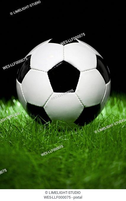 Football on grass, close up