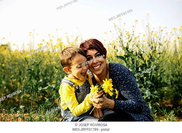 Portrait of happy mother with little son in nature