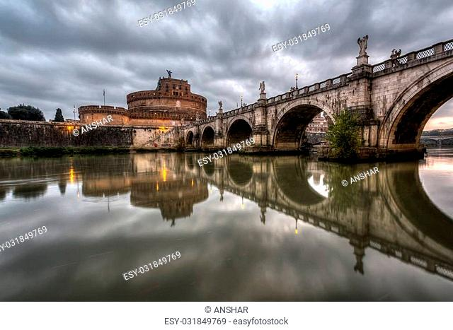 Castle of Holy Angel and Holy Angel Bridge over the Tiber River in Rome at Dawn, Italy - HDR version