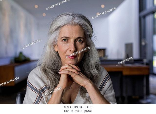 Portrait confident, serious mature woman with long, gray hair