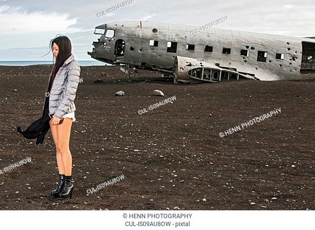 Fashion shoot on the south coast of Iceland, The plane in the background is a crash landed DC 3 from the US Navy