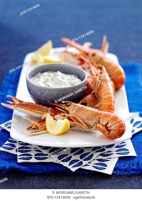 Langoustines with lemon wedges and a dip