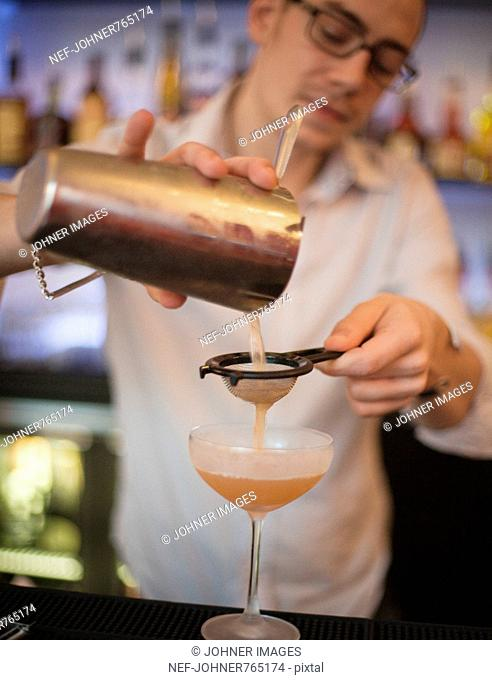 Bartender making a cocktail, Sweden
