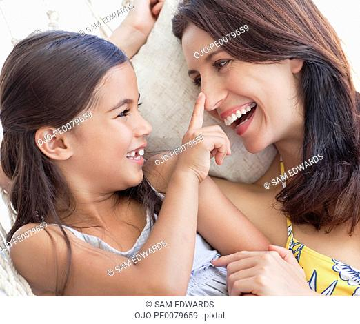 Close up of smiling daughter touching mother's nose