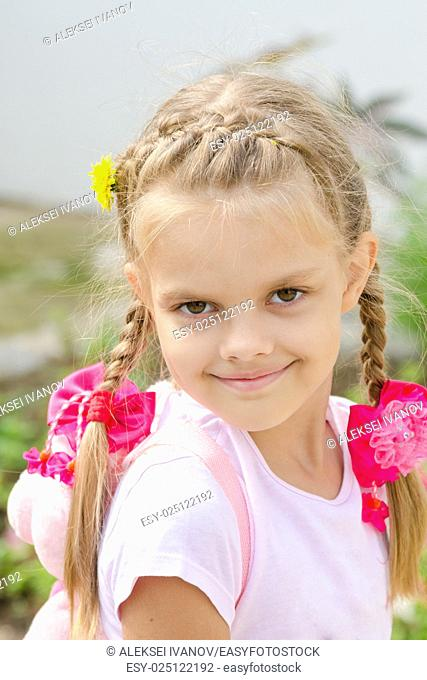 Portrait of a beautiful six year old girl with blond hair