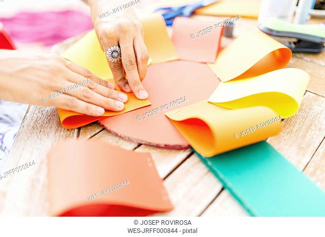 Woman making a cardboard rosette