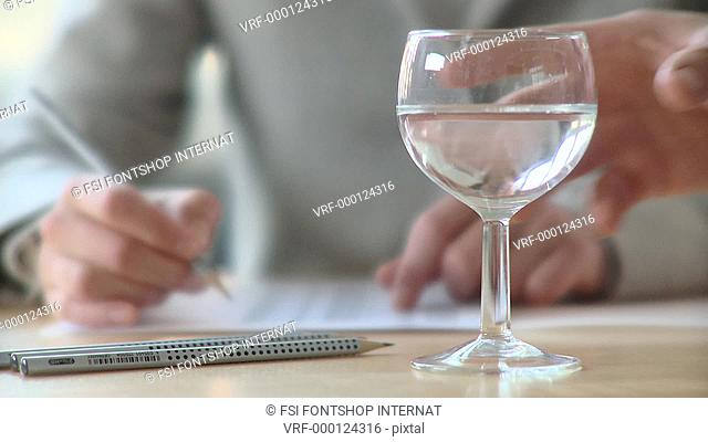 Lockdown, CU, Selective Focus, Businessman taking glass of water, focus on hand