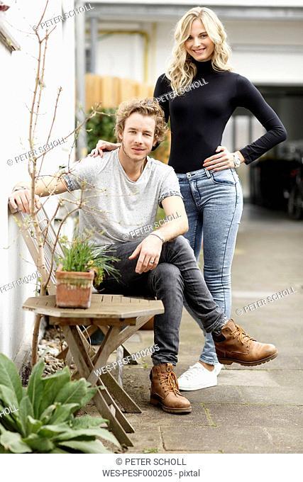 Young couple in backyard