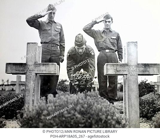 American soldiers in France pay tribute to fallen French soldiers at a world war I cemetery at Suippes, France 1945 World History Archive