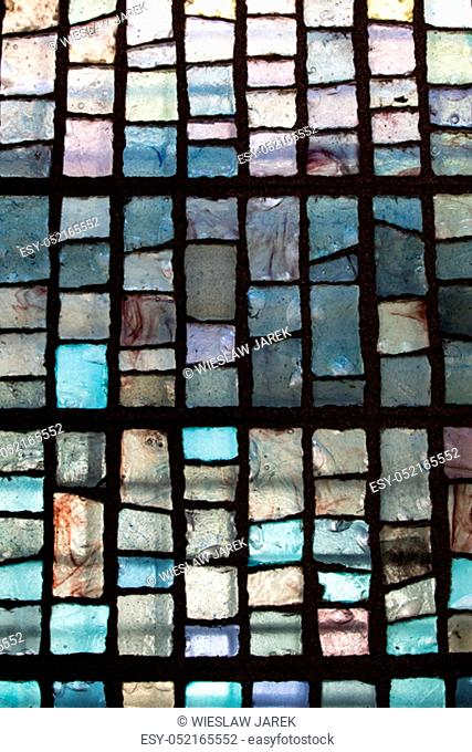 Colorful mosaic on the wall, abstract glass background