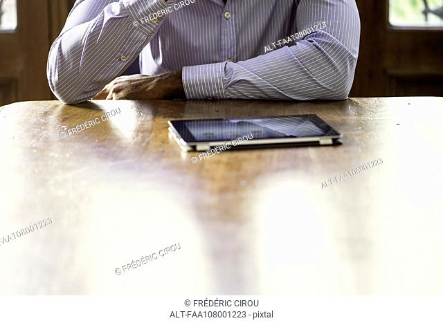 Businessman using digital tablet for video conference