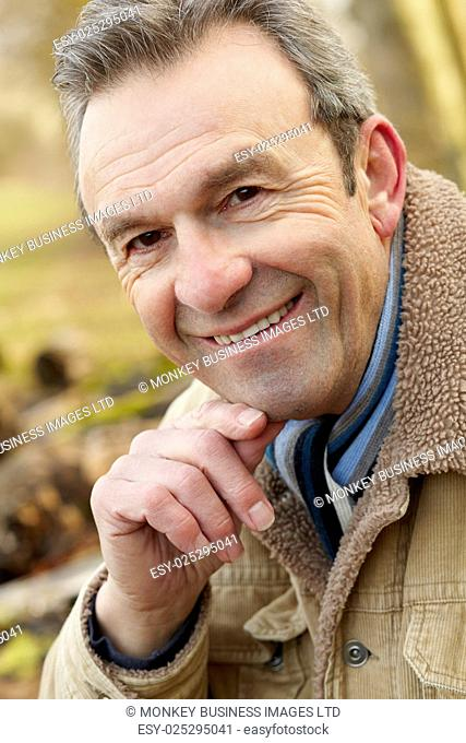 Portrait senior man outdoors in winter