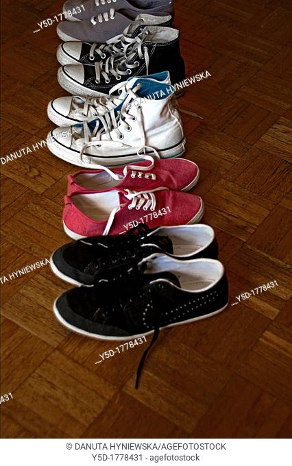 many sneakers pairs in a raw