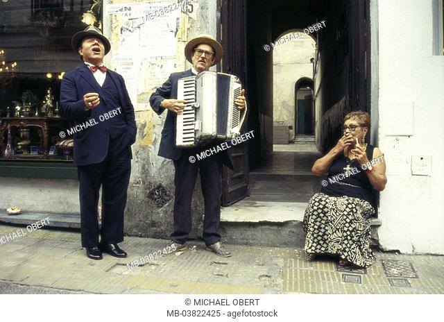 Argentina, Buenos Aires, district San Telmo, street music, singers, Musicians, tango, spectator,  Latin America, South America, capital, city, house, passageway